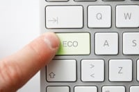 Man pressing eco button on keyboard ©Depositphotos/leeser